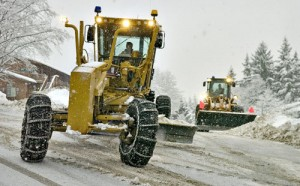 Snowy Juneau plows